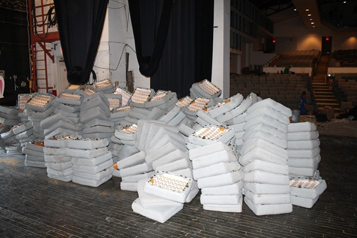 Seat cushions piled on stage.