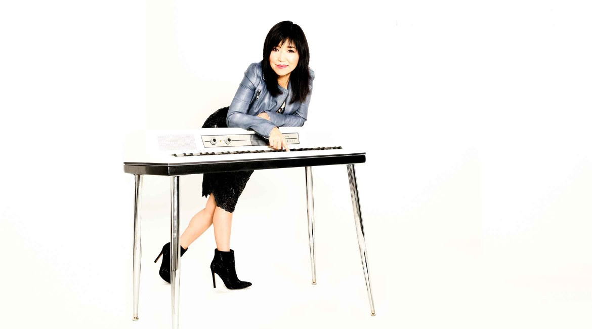 Keiko Matsui leaning over a keyboard