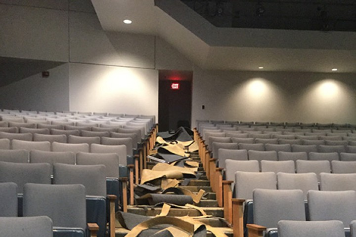 Removal of the old carpeting in the auditorium