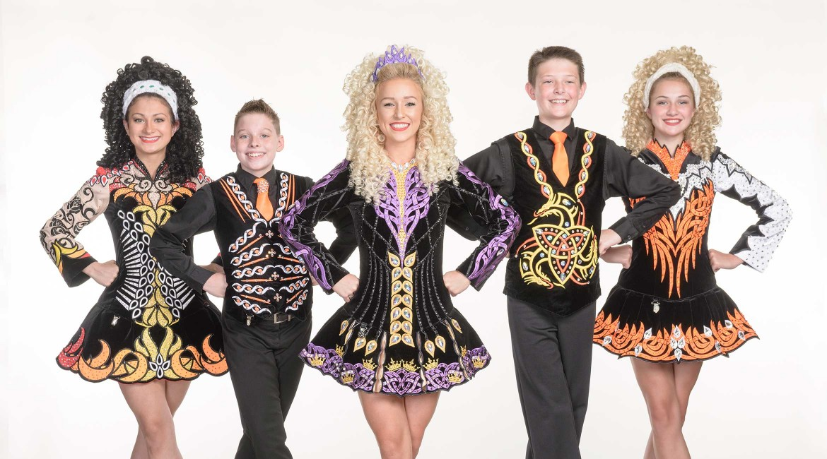 Five young dancers in uniform, two boys and three girls.