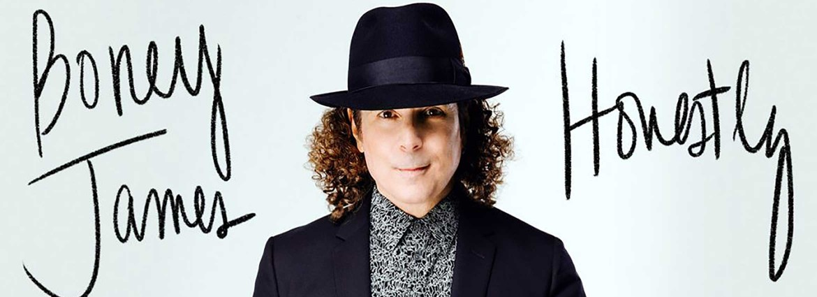 A picture of Boney James with his name to the left of him and the word