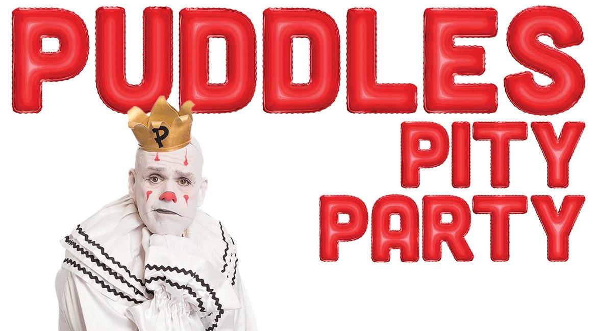 Puddles the Clown with chin rested on fist to promote Puddles Pity Party