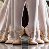 feet in ballet slippers