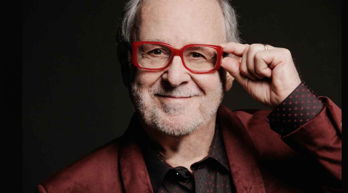 Bob James holding frame of red glasses
