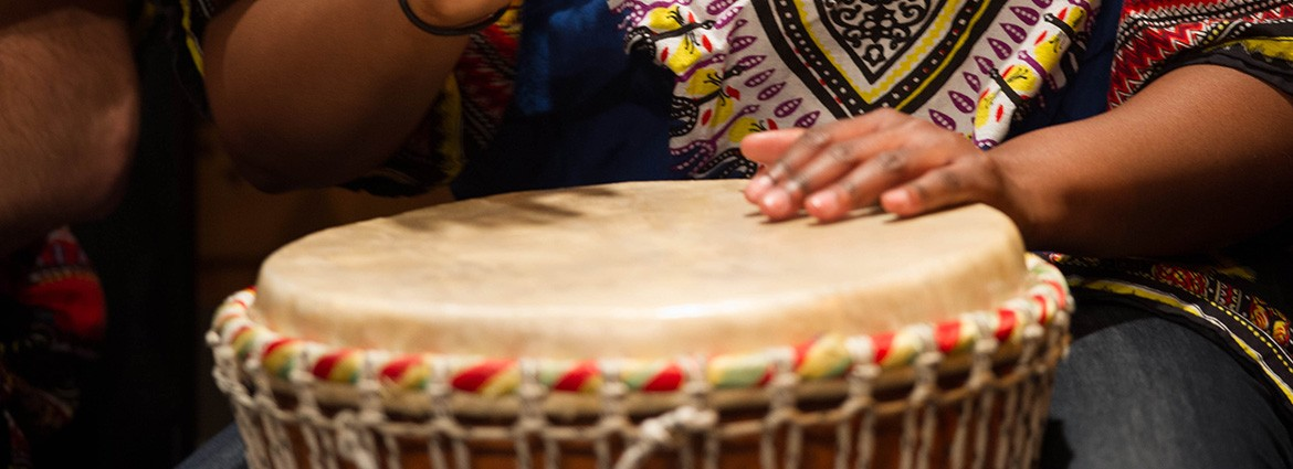Woman's hands playing the djembe