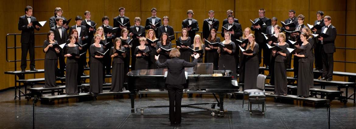 Buffalo State Chamber Choir performing on stage under the direction of Dr. Victoria Furby