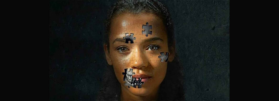 African American Woman with puzzle pieces on her face revealing robot beneath