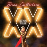 Brian Culbertson in front of the XX logo