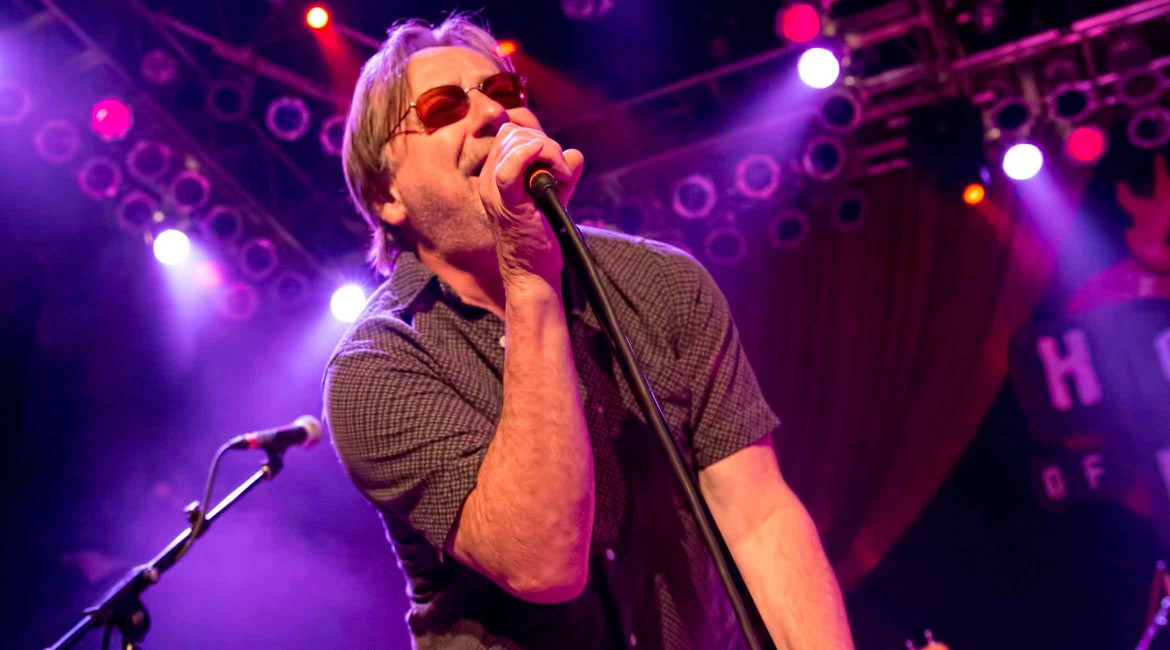 Southside Johnny singing into microphone